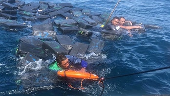 Suspected drug smugglers clung to floating bales of cocaine for hours in shark-infested waters: cops