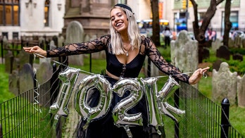 Woman celebrates 'death' of $102G in student loans with graveyard photo shoot
