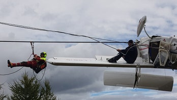 Small plane gets caught in ski lift cables after crash in Italian Alps