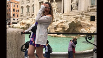 Tourist accidentally photographs couple's engagement at Trevi Fountain, hopes to find them