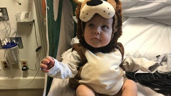 Rhode Island mom who lost son, 1, to cancer asking for Halloween-themed rocks for boy's grave