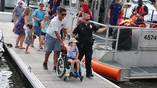 Florida boy, 5, battling aggressive brain cancer gets to patrol with Coast Guard, police