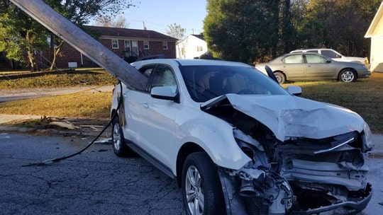 North Carolina parent 'extremely lucky' after utility pole smashes through car window