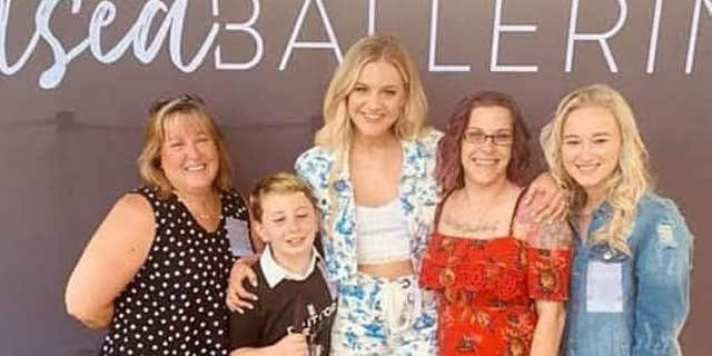 Country song star Kelsea Ballerini astounded Ayden with an electric guitar customized with his name in Braille. Ayden is blind and was diagnosed with mind cancer in 2013, according to his mother, Tiffany Henke.