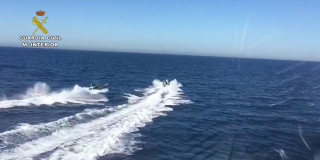 The two boats were involved in a high-speed chase off Spain on Friday.