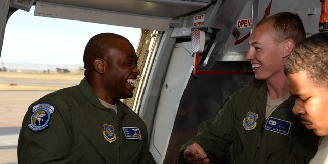 Tech. Sgt. Kenneth Cook (Left) shares a giggle with Staff Sgt. Jack McCoy. (U.S. Air Force print by Tech. Sgt. James Hodgman)