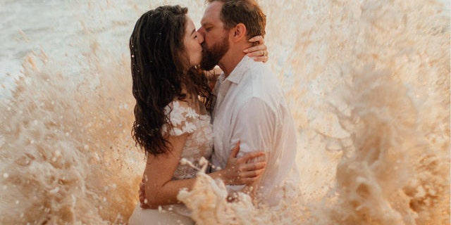 Tim and Bekah Blakely-Savage get an unexpected surprise during wedding photoshoot. Sunny Golden/Sunny Golden Photos