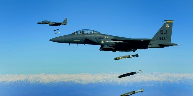 U.S. Air Force F-15E Strike Eagles drop 2,000-pound munitions on a cave in eastern Afghanistan in 2009. (U.S. Air Force/Staff Sgt. Michael B. Keller)