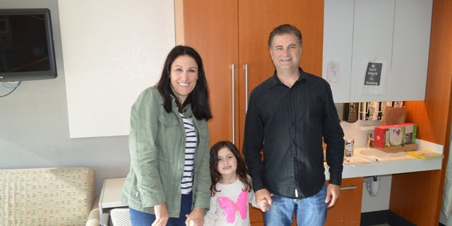 Sophia and her parents shortly before they left the hospital.