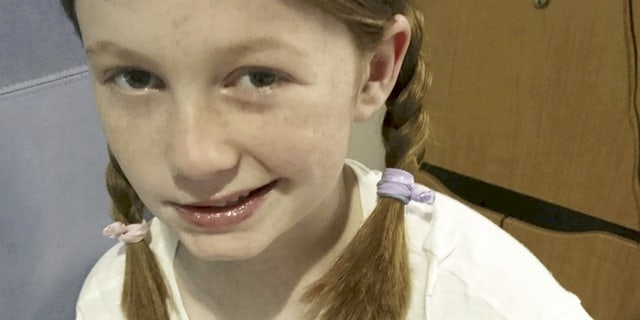 Gracie Whittick in hospital following the stroke. (SWNS)