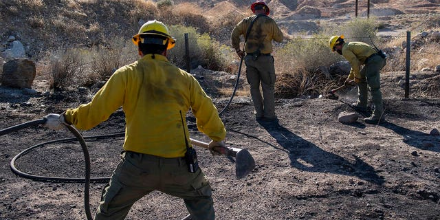An engine crew looks for any remaining hot spots from the Tick Fire, Oct. 25, 2019, in Santa Clarita, Calif. (Associated Press)
