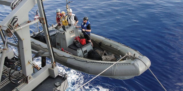 Sailors aboard the guided-missile cruiser USS Leyte Gulf (CG 55) conduct rigid-hull inflatable boat operations. (U.S. Navy photo by Ensign Lisa M. Holsberger)