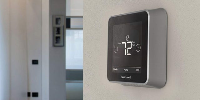 A Honeywell smart thermostat is seen above.