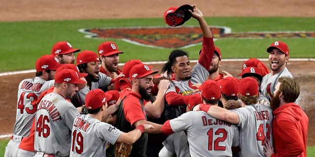 St. Louis Cardinals relief pitcher Genesis Cabrera waves his hat in the air as he celebrates with teammates after the Cardinals beat the Atlanta Braves 13-1 in Game 5 of their National League Division Series baseball game Wednesday, Oct. 9, 2019, in Atlanta. (Associated Press)