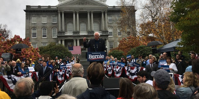 Democratic presidential candidate Sen. Bernie Sanders of Vermont holds a rally outside the New Hampshire Statehouse, in Concord, N.H., on Oct. 31, 2019