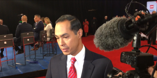 Democratic presidential candidate Julian Castro speaks with reporters in the spin room following the fourth round Democratic primary debate in Westerville, Ohio on Oct. 15, 2019