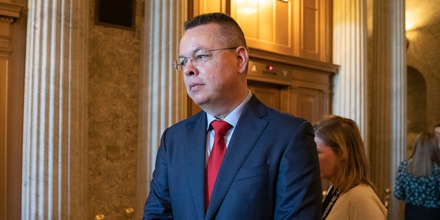 Pastor Andrew Brunson walks from the Senate chamber after giving the Senate opening prayer on Capitol Hill in Washington, Tuesday, Oct. 15, 2019. Brunson flew out of Turkey one year ago after a Turkish court convicted him of terror links but freed him from house arrest he'd already spent nearly two years in detention. (AP Photo/Manuel Balce Ceneta)