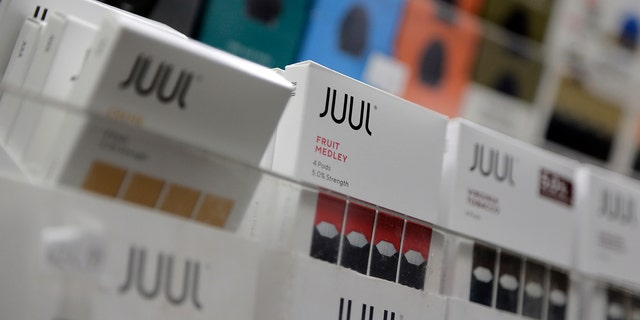 In this Dec. 20, 2018, file photo Juul products are displayed at a smoke shop in New York. (AP Photo/Seth Wenig)