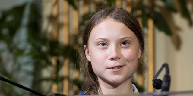 Swedish climate activist Greta Thunberg speaks to reporters after receiving the key to the city of Montreal during a ceremony in Montreal last month. (Graham Hughes/The Canadian Press via AP)