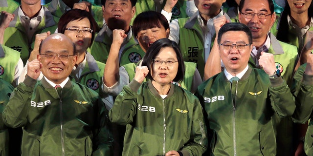 Taiwan President and presidential candidate of Democratic Progressive Party (DPP) in the 2020 elections Tsai Ing-wen, center, cheers with party members during the party's anniversary in Taipei, Taiwan, Saturday, Sept. 28, 2019. (AP Photo/Chiang Ying-ying)