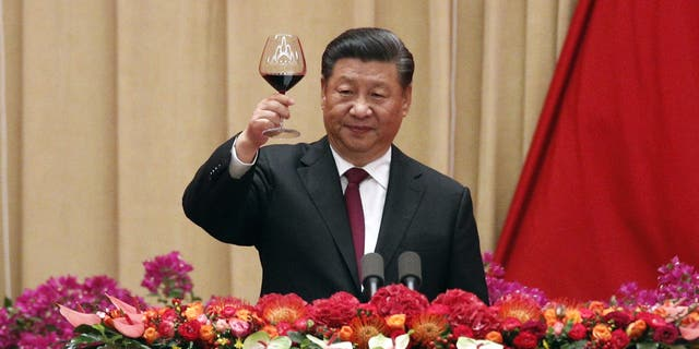 Chinese President Xi Jinping after delivering his speech at a dinner marking the 70th anniversary of the founding of the People's Republic of China at the Great Hall of the People in Beijing, Monday, Sept. 30, 2019. (AP Photo/Andy Wong)