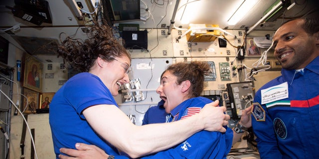 NASA has announced that the International Space Station's two women will pair up for a spacewalk on Oct. 21 to plug in new batteries. (NASA via AP)