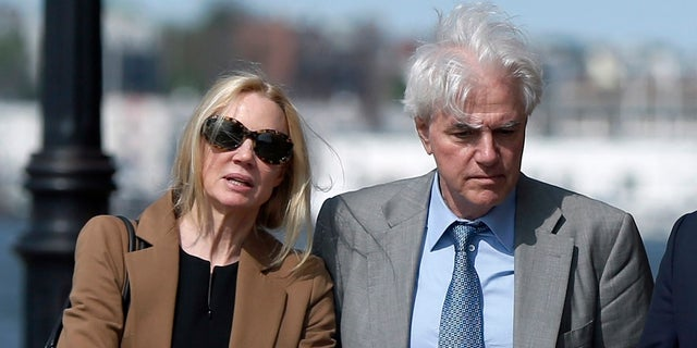 Marcia and Gregory Abbott leave federal court after pleading guilty in the college admissions scandal (AP Photo/Michael Dwyer, File)