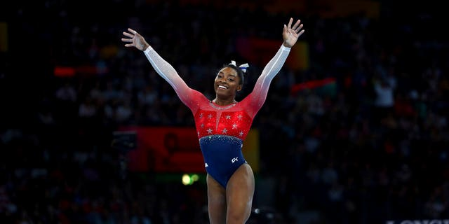 """I feel like I never think of records,"" Biles says of her performances. ""I just go out there and do what I came to do, which is compete for the country."""