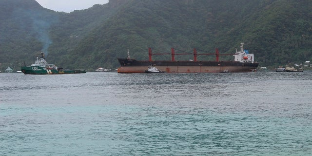 This May 11, 2019, file photo shows the North Korean cargo ship Wise Honest, middle, being towed into port in Pago Pago, American Samoa. (AP Photo/Fili Sagapolutele, File)