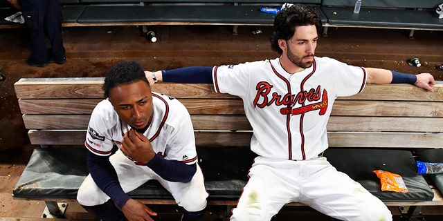 Atlanta Braves' Dansby Swanson, right, and Ozzie Albies sit in the dugout after the Braves lost 13-1 to the St. Louis Cardinals in Game 5 of their National League Division Series baseball game Wednesday, Oct. 9, 2019, in Atlanta. (Associated Press)