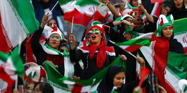 Iranian women cheer during a soccer match between their national team and Cambodia in the 2022 World Cup qualifier at the Azadi (Freedom) Stadium in Tehran, Iran, on Thursday.