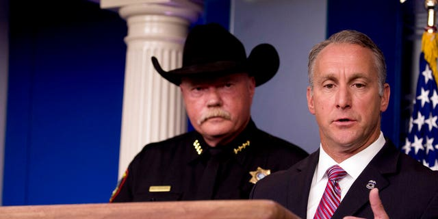 Immigration and Customs Enforcement Director Matt Albence, right, accompanied by sheriffs from around the country including Tarrant County, Texas Sheriff Bill Waybourn, left, speaks in the Briefing Room at the White House in Washington, Thursday, Oct. 10, 2019. (AP Photo/Andrew Harnik)