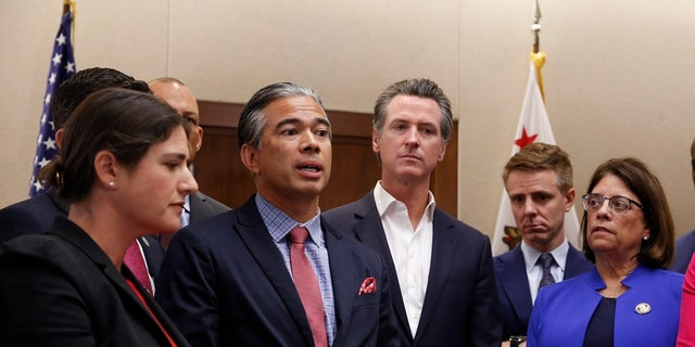 Assemblyman Rob Bonta, D-Oakland, second from left, flanked by California Gov. Gavin Newsom, center, and other lawmakers, discusses his measure on for-profit detention facilities on Friday in Sacramento.  (AP Photo/Rich Pedroncelli)
