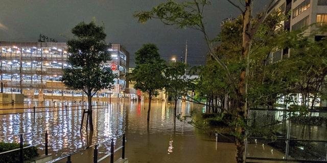 This Oct. 12, 2019 photo by @ar_kaz shows the flooded streets at Kawasaki, near Tokyo, Japan. Japan, including Tokyo, after a powerful typhoon unleashed heavy rainfall. (@ Ar_kaz via AP)