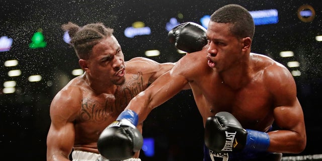 Patrick Day, right, follows through on a right to Kyrone Davis during the fourth round of a March 2018 WBC super welterweight championship boxing match in New York, (AP Photo/Frank Franklin II, File)