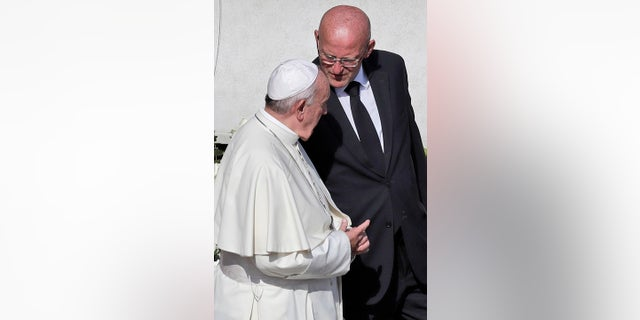 Vatican head of security Domenico Giani, right, shares a word with Pope Francis. (AP Photo/Alessandra Tarantino)