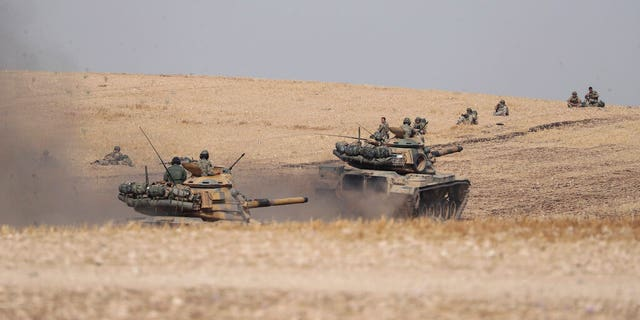 Turkish tanks and troops stationed near Syrian town of Manbij, Syria, Tuesday.