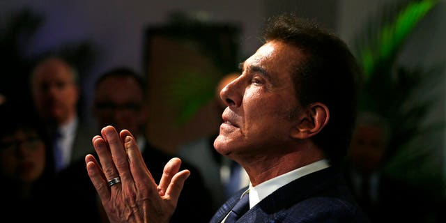 FILE: Casino mogul Steve Wynn gestures listens during a news conference in Medford, Mass.