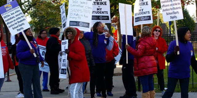 Striking teachers picket outside George Leland Elementary School on Chicago's West Side Thursday, Oct. 17, 2019.