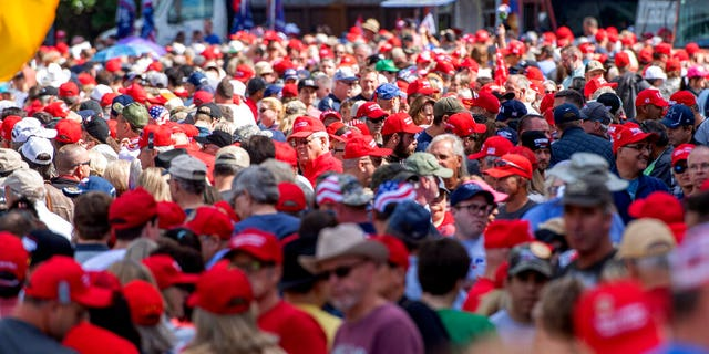A sea of red hats as supporters of President Trump lined up to enter the campaign rally on Thursday in Dallas. (AP Photo/Jeffrey McWhorter)