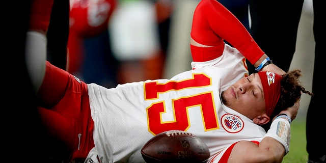 Kansas City Chiefs quarterback Patrick Mahomes (15) lies on the field after being injured against the Denver Broncos during the first half of an NFL football game, Thursday, Oct. 17, 2019, in Denver. (Associated Press)