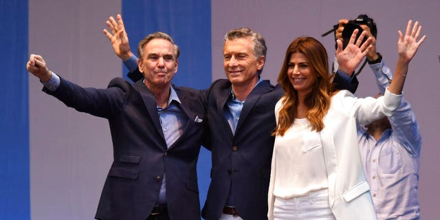 "Presidential candidate for ""Juntos Por el Cambio"" party and Argentina's President Mauricio Macri, center, his wife Juliana Awada, right, and his running-mate Miguel Angel Pichetto, wave to supporters during a rally at ""9 de Julio"" avenue in Buenos Aires, Argentina, Saturday, Oct. 19, 2019."