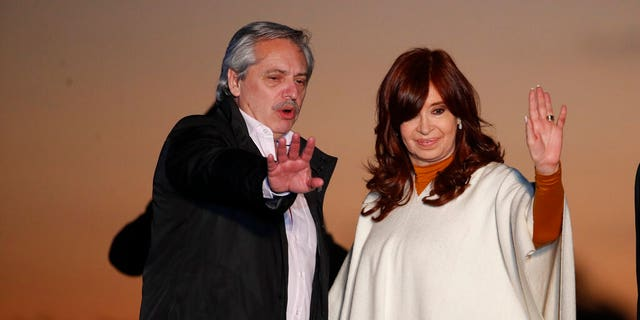 In this Oct. 17, 2019 photo, presidential candidate Alberto Fernandez, left, and running-mate Cristina Fernandez de Kirchner, wave to supporters at a campaign rally in Santa Rosa, Argentina.