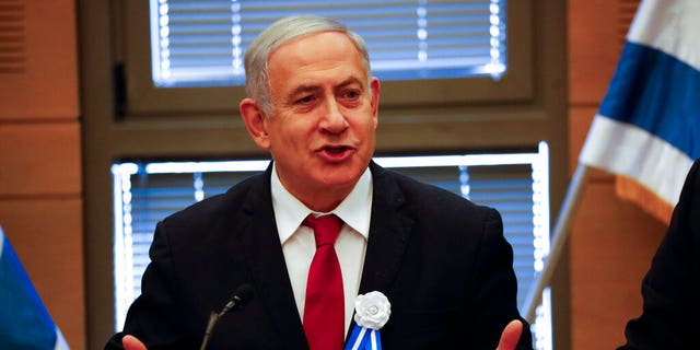 FILE: Israeli Prime Minister Benjamin Netanyahu speaks during his party's faction meeting in Jerusalem.