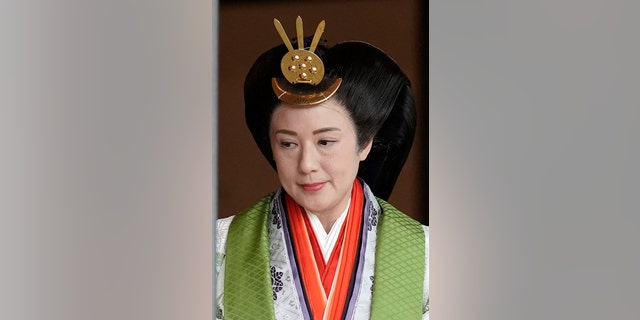 Japanese Empress Masako leaves the ceremony hall after Emperor Naruhito proclaimed his enthronement at the Imperial Palace in Tokyo, Tuesday, Oct. 22, 2019. (Kimimasa Mayama/Pool Photo via AP)