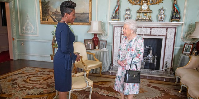 Queen Elizabeth II receives the High Commissioner for Grenada, Lakisha Grant, during a private audience at Buckingham Palace, London.