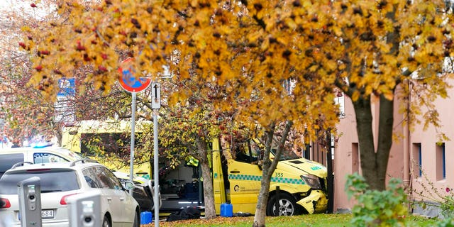 A damaged ambulance is seen crashed into a building after an incident in the center of Oslo, Tuesday, Oct. 22, 2019. Norwegian police opened fire on an armed man who stole an ambulance in Oslo and reportedly ran down several people.