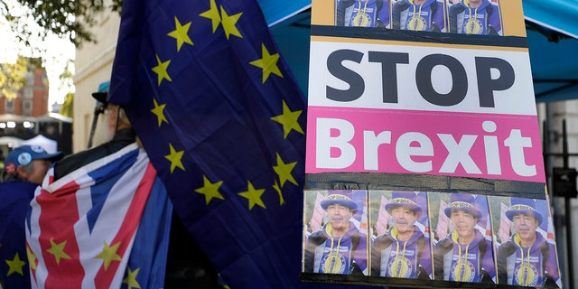 An anti-Brexit demonstrators banner near Parliament in London, Tuesday, Oct. 22, 2019.