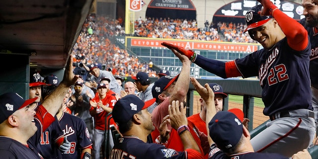 Washington Nationals' Juan Soto celebrates in the dugout after his home run against the Houston Astros during the fourth inning of Game 1 of the baseball World Series Tuesday, Oct. 22, 2019, in Houston. (AP Photo/Matt Slocum)