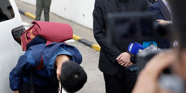 Chan Tong-kai, left, bows after talking to the media as he is released from prison in Hong Kong Wednesday.